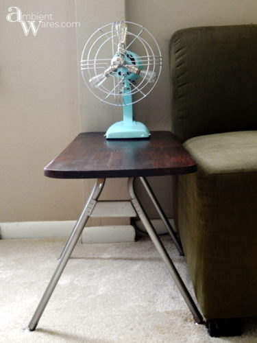 Look at what an old mid-century rusty table top fan can be turned into! A beautiful piece of Industrial Home Decor. For this and more unique ideas, visit AmbientWares.com #fanlamp #uniqueproject #vintagestylelight #rustyfan