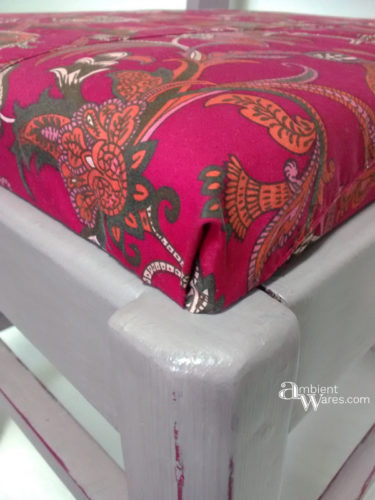 Use an old piece of clothing to recover a small piece of furniture. There are some cute clothes out there! For this and more great ideas, visit AmbientWares.com