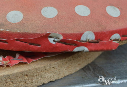 Old red and white polka dot fabric on bistro chairs by AmbientWares.com