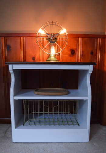 This old beat up microwave cart got a simple farmhouse styled makeover. For this and more fun projects, visit AmbientWares.com #farmhousestyled #oldmicrowavecart #oldtvcart