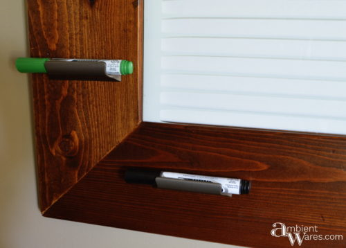 Close up of the dry erase markers in their drawer handle holders
