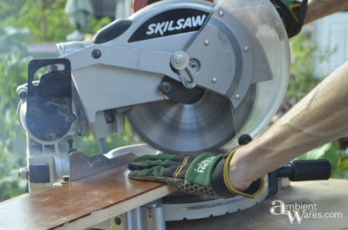 Cutting 45 degree angle of frame piece with miter saw