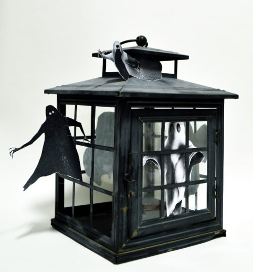Take an Old Broken Lantern and Turn it into a Spook House! Perfect addition to your Halloween Mantle! For this and more unique ideas, visit AmbientWares.com