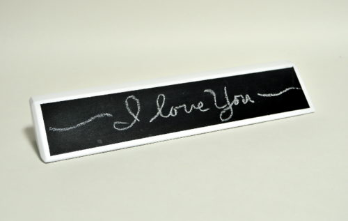 I love you written on chalkboard name plate.JPG