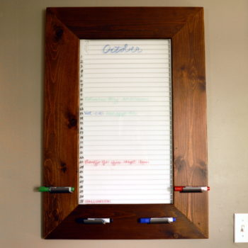 Create this awesome DIY framed dry erase board from an old refrigerator shelf! ~ ambientwares.com