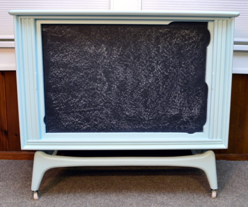 I love upcycled furniture ideas like this one! She transformed an old tube TV shell into the cutest organization station with a chalkboard as well as a shelf for added storage! For this and more unique ideas, visit AmbientWares.com