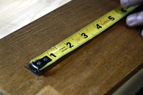 Measuring the wood that will become the planter's lid