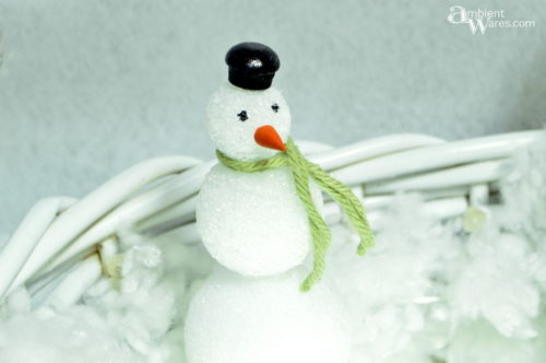 Little foam snowman in the basket made into a Winter Wonderland