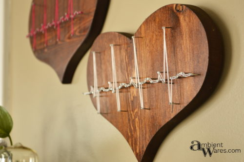 Thrift store wooden hearts get an awesome trash to treasure makeover with string art! AmbientWares.com