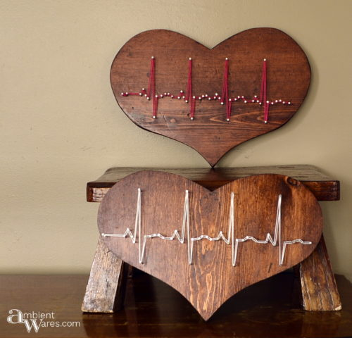 Two thrift store wooden hearts refinished and made to display a heartbeat in string art by AmbientWares.com