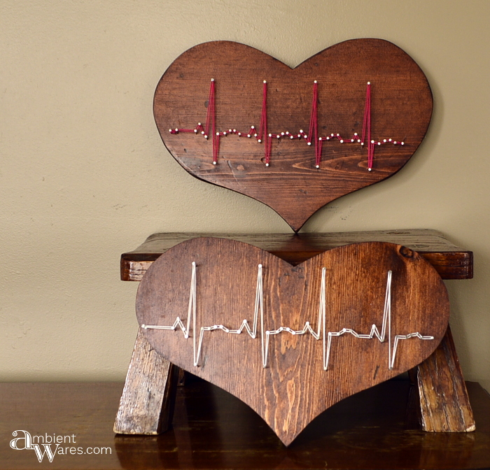 Two thrift store wooden hearts refinished and made to display a heartbeat in string art www.ambientwares.com - www.ambientwares.com