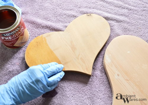 Using wood conditioner on the wooden hearts before staining by AmbientWares.com