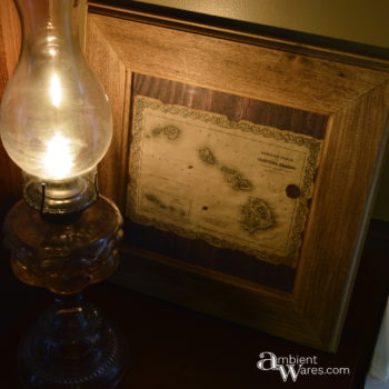 Hawaiian antiqued map with hurricane lamp