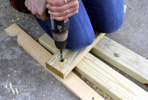 Pre drilling our DIY furniture dolly. Visit AmbientWares.com for this and more great DIY and craft ideas!