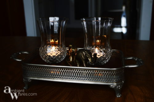 Adding a piece of wood to a silver plated casserol dish along with some thrift store sconces make a great looking centerpiece! For this and more unique ideas, visit, AmbientWares.com