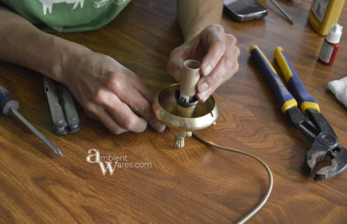 Re-attaching the socket insulator