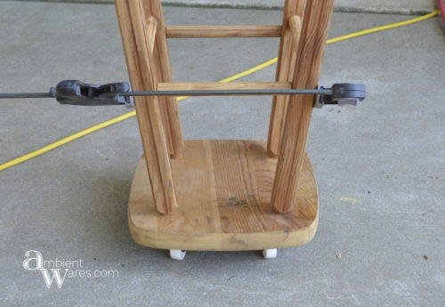 Repurposed_Upside_Down_Stool_Gift_Wrapping_Paper_Ribbon_Station_Casters_On_ambientwares.com