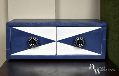 All this little 2 drawer box needed was an atomic design makeover. Here it has two tirangle shapes but, just switch the drawers and you have a diamond! www.AmbientWares.com